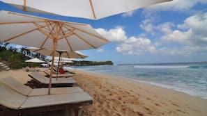 Beach nearby, white sand, beach towels, surfing