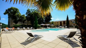 2 outdoor pools, open 9:30 AM to 8:00 PM, pool umbrellas, pool loungers