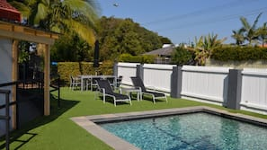 Outdoor pool, open 8:00 AM to 9:00 PM, pool loungers