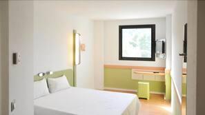 Italiaanse Frette-lakens, een kluis op de kamer, een bureau
