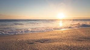 Beach nearby, white sand, beach shuttle, beach umbrellas