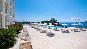 Seasonal outdoor pool, open 10 AM to 7 PM, pool umbrellas, sun loungers