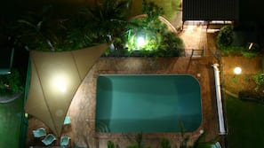 Outdoor pool, open 7:00 AM to 9 PM, pool loungers