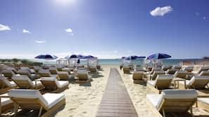 On the beach, sun loungers, beach umbrellas, beach bar