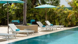 Outdoor pool, open 8:00 AM to 6:00 PM, free cabanas, pool umbrellas