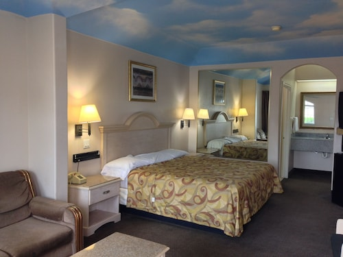Check Expedia for Availability of Camelot Inn & Suites McCarty