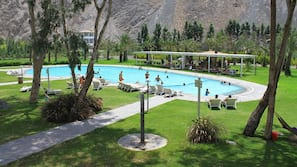 Outdoor pool, open 9 AM to 4 PM, pool umbrellas, sun loungers