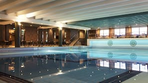 Indoor pool, open 7:00 AM to 11:00 PM, sun loungers, lifeguards on site