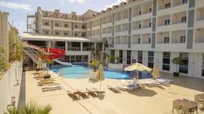 Indoor pool, seasonal outdoor pool, open 10 AM to 6 PM, pool umbrellas