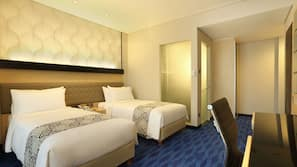 Premium bedding, down duvets, pillow-top beds, in-room safe