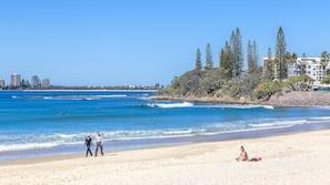 Beach nearby, white sand, beach umbrellas