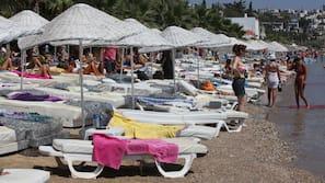 Private beach, sun-loungers, beach umbrellas, beach bar