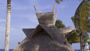 On the beach, white sand, free beach cabanas, sun loungers