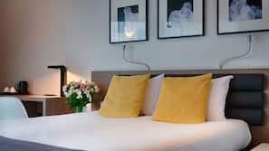 Premium bedding, in-room safe, laptop workspace, free cribs/infant beds