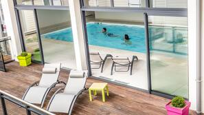 Indoor pool, open 7 AM to 8 PM, pool loungers