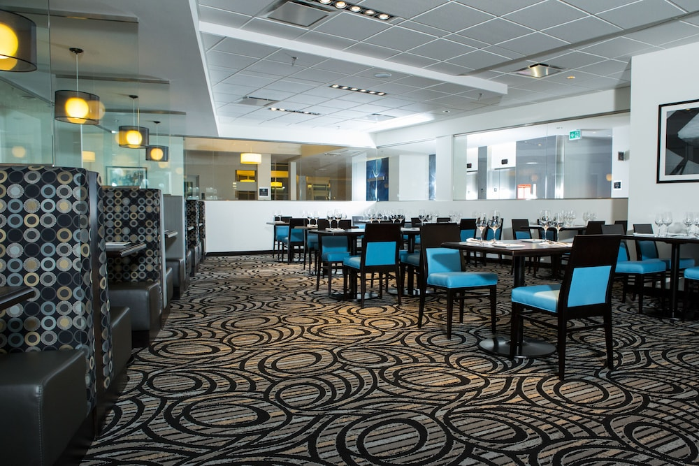 Restaurant, The Grand Winnipeg Airport Hotel by Lakeview