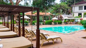 Outdoor pool, open 7:00 AM to 7:00 PM, free cabanas, pool umbrellas