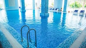 Indoor pool, seasonal outdoor pool, pool umbrellas, sun loungers