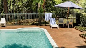 Seasonal outdoor pool, open 6 AM to 8 PM, pool loungers