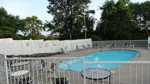 Seasonal outdoor pool, open 9:30 AM to 8:30 PM, pool umbrellas