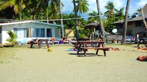 On the beach, sun-loungers, beach massages, beach volleyball