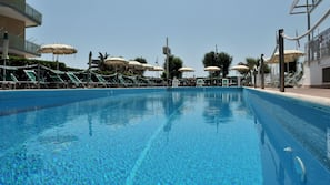 Seasonal outdoor pool, open 8:30 AM to 7 PM, pool umbrellas