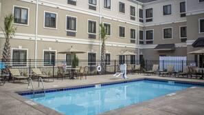 Seasonal outdoor pool, open 10:00 AM to 8:30 PM, pool umbrellas