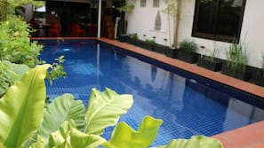 Outdoor pool, open 7 AM to 11 PM, pool umbrellas, pool loungers