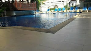 Outdoor pool, open 7 AM to 10 PM, pool umbrellas, pool loungers