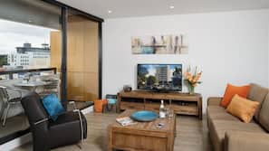 50-inch flat-screen TV with cable channels, TV