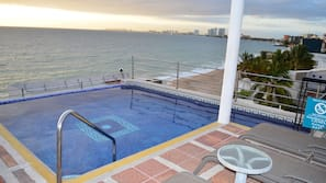 Outdoor pool, open 10 AM to 10 PM, sun loungers