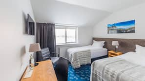 Hypo-allergenic bedding, blackout drapes, free WiFi, linens
