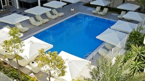 Seasonal outdoor pool, open 8:00 AM to 6:30 PM, pool umbrellas