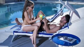 2 outdoor pools, open 9 AM to 8 PM, pool umbrellas, pool loungers