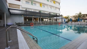 Seasonal outdoor pool, open 8 AM to 7 PM, pool umbrellas, pool loungers