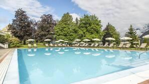 3 indoor pools, seasonal outdoor pool, open 7 AM to 7 PM, pool umbrellas