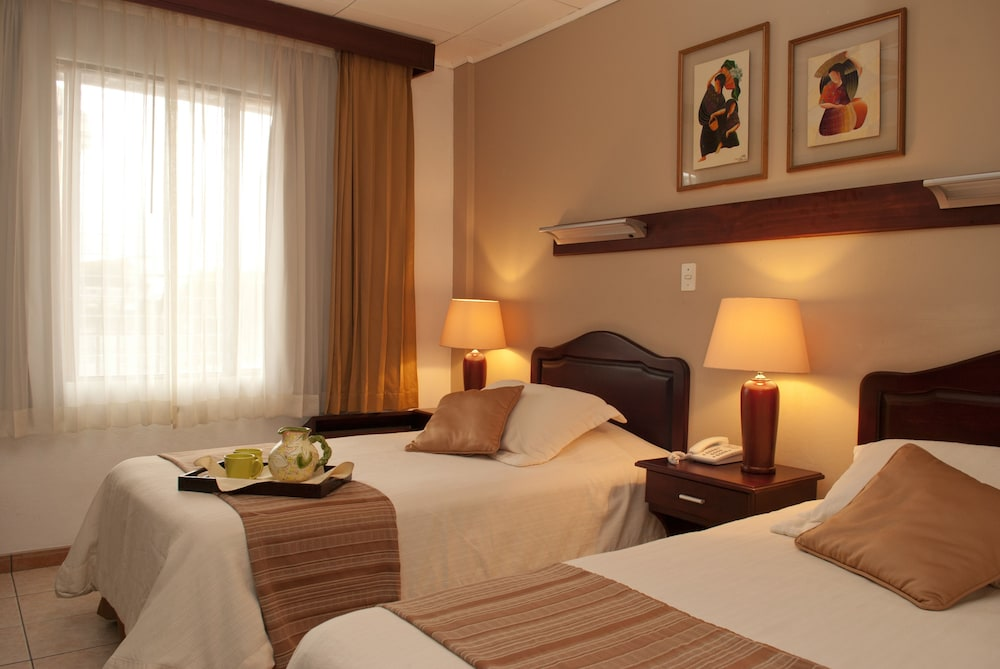 Room, La Sabana Hotel Suites Apartments
