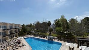 Indoor pool, 3 outdoor pools, open 9:00 AM to 8:00 PM, pool umbrellas
