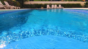 Outdoor pool, open 9:00 AM to 10:00 PM, sun loungers