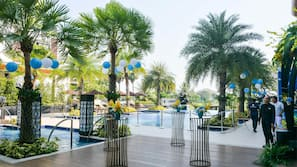 Outdoor pool, open 7:00 AM to 8:00 PM, free cabanas, pool umbrellas