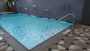 Seasonal outdoor pool, open 8:00 AM to 9:00 PM, pool umbrellas