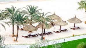 Private beach, white sand, sun loungers, beach umbrellas