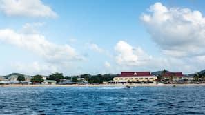Beach nearby, beach umbrellas, 3 beach bars