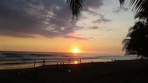 On the beach, sun loungers, beach towels, beach yoga