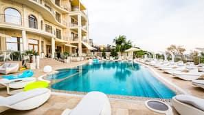 Seasonal outdoor pool, open 7:00 AM to 8:00 PM, pool umbrellas