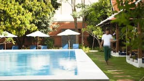 Outdoor pool, open 7 AM to 10 PM, free pool cabanas, pool umbrellas