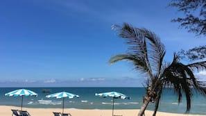 On the beach, sun-loungers, beach umbrellas