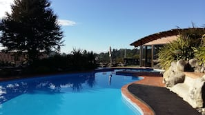 Indoor pool, outdoor pool, open 8 AM to 8 PM, pool umbrellas