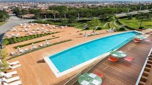 Indoor pool, outdoor pool, open 7 AM to 10 PM, pool umbrellas