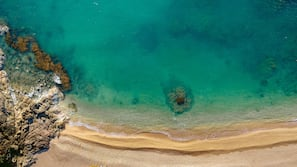 Private beach, beach umbrellas, beach towels, windsurfing
